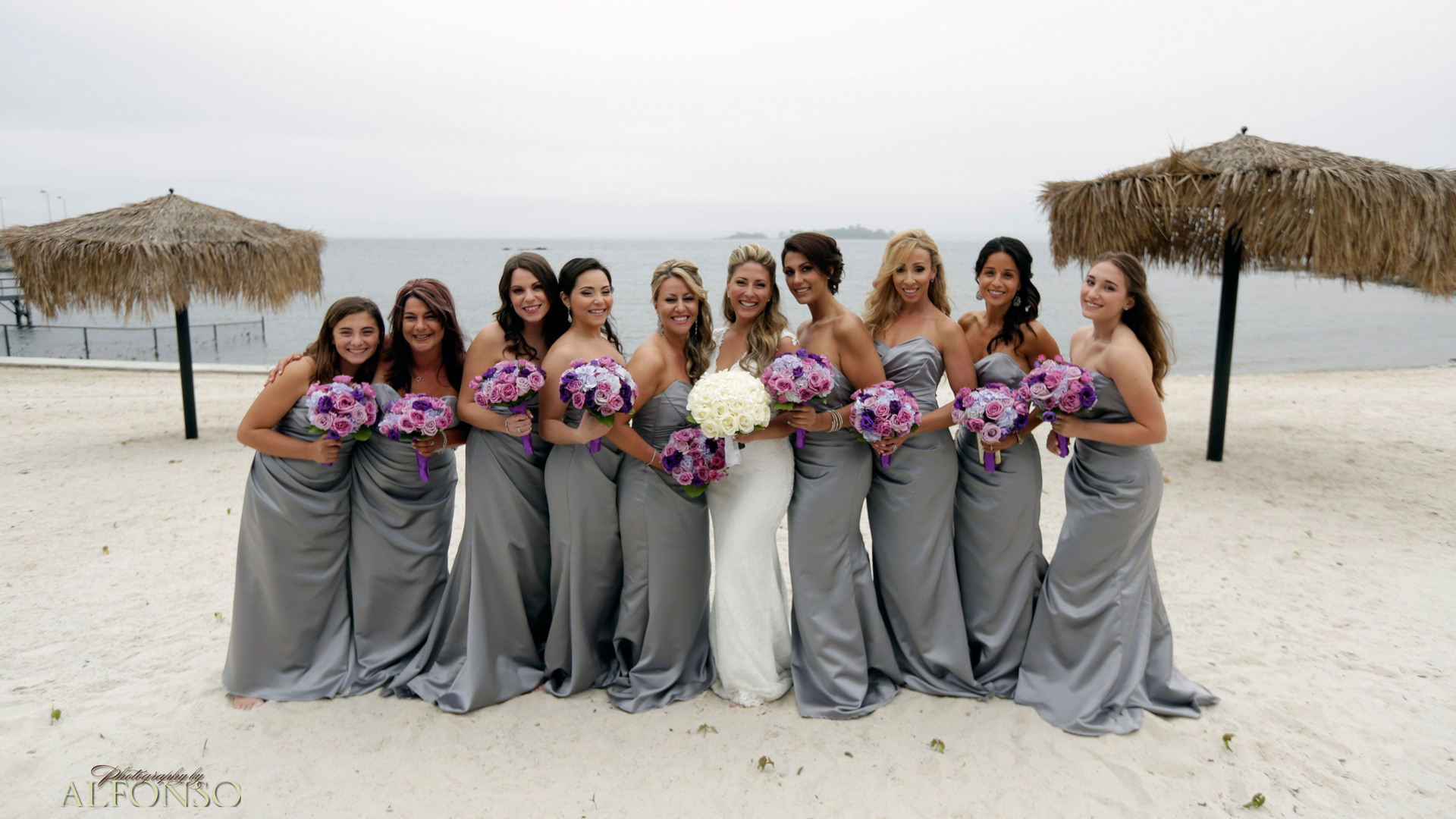 Bride with Flower Girls on the Beach