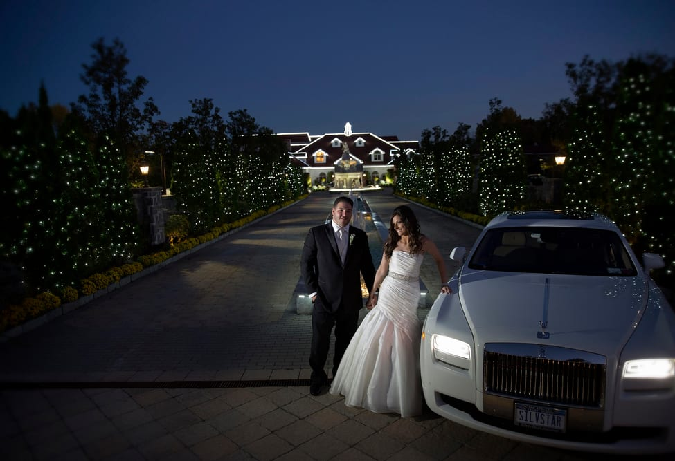 Newly Married Couple Standing Beside Rolls Royce